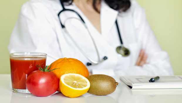 A Doctor Displaying Healthy Diet And Supplements That Pevent Vitamin Deficiency