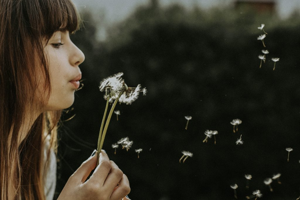 Woman Blowing Dandelion, Causes Asthma