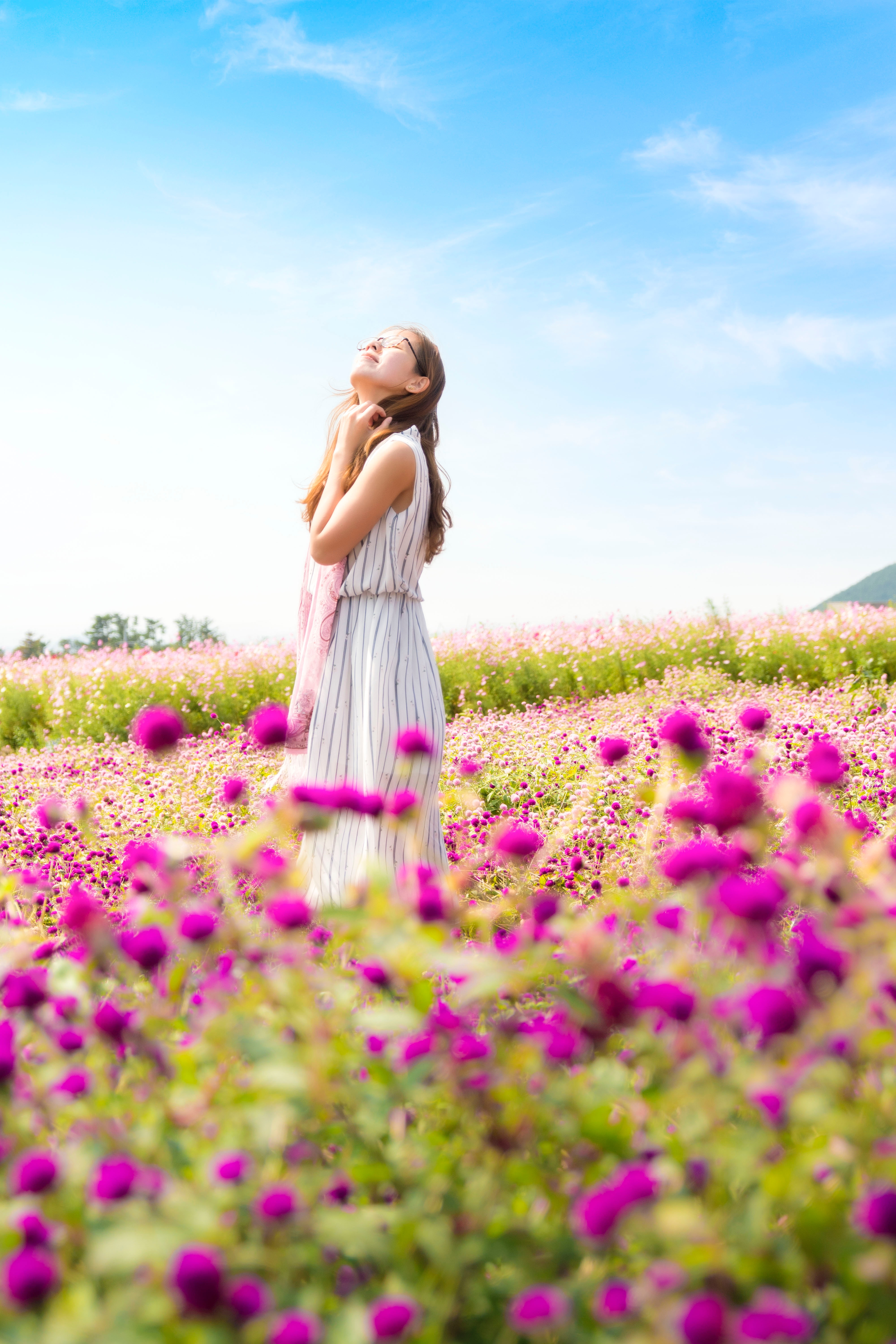 Woman Feeling Happy in A Field Of Flowers. Free From Anxiety and Depression