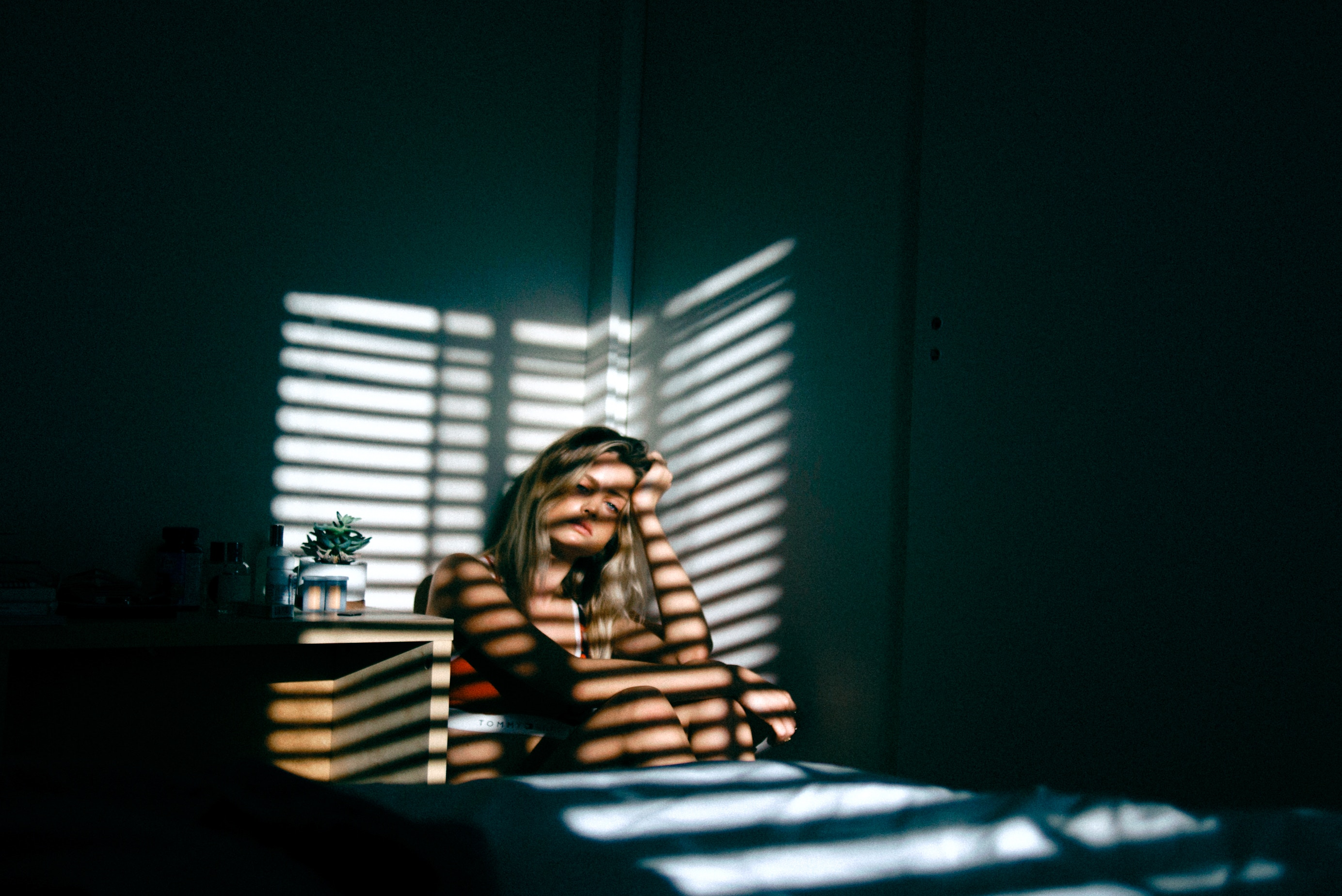 Woman Sitting In a Dark room, Experiencing Anxiety And Depression